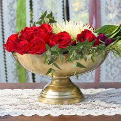 Add golden shine to your wedding, event and home decor with our 6 inch tall metal compote vase.