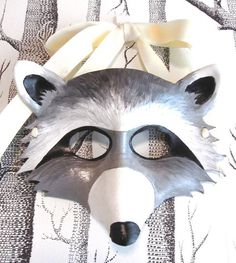 Hey, I found this really awesome Etsy listing at http://www.etsy.com/listing/59061078/raccoon-leather-mask-adult-size-made-to