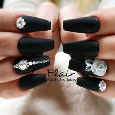 matte Black Coffin nails with Studs and Flowers. The studded white flowers on the bold black matte color is another great way to embellish your coffin nails with style.