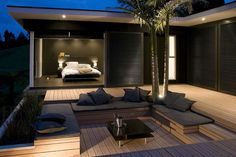 Bedroom with outdoor sitting area. I'd add a firepit w/retractable canopy for the day.