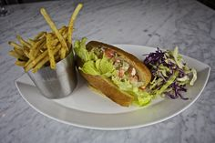 Lobster Roll. Toasted Brioche, butter lettuce & herbed cole slaw.