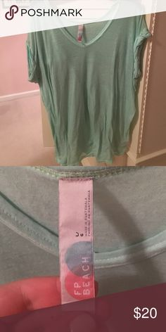 FREE PEOPLE beach v neck Love this light green color!! This v neck t shirt is perfect for any casual occasion! It's made by the free people beach section because it could also be a great coverup! Great condition, minimal wear Free People Tops Tees - Short Sleeve
