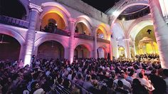 People attend a classical concert in the war-torn Maronite cathedral at the Old City of Aleppo, Syria. Photo: Reuters/Omar Sanadiki