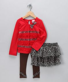 This set's soft stretchy knit leggings, frilly tulle skirt and coordinating top create a great go-to ensemble for any day. Thanks to a silky smooth lining, the skirt can be worn alone or layered over leggings for complete versatility.