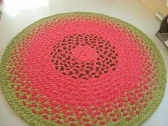 "Ready to ship 40"" watermelon rug created from USA organic cotton and recycled t shirts. $163.00, via Etsy."