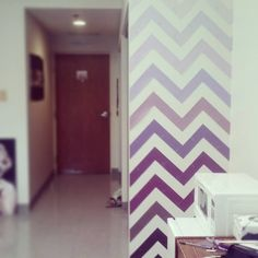 Chevron accent wall! Made from paint samples! Great way to decorate a dull college dorm room!--love the purple!