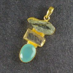 Pendant (no chain included) features rough, raw green amethyst and kunzite, and smooth, facetted aqua chalcedony, set in hammered 22-karat gold-plated brass bezels. UK seller. £16.25