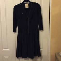 Love this dress!! Deep navy. Military nod while still being very feminine. Hits about 2inches above the knee on 5'8. Looks amazing with a great pair of brown boots or cute wedges in the spring! Dry clean only. Anthropologie Dresses Midi