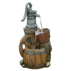 The Old Fashion Pump Barrel Fountain is sure to be the apple of every visitor's eye. This multi-tiered, fiberglass fountain has a rustic look of metal and wood. Water flows from a old hand pump into a Garden Water Pump, Garden Water Fountains, Small Fountains, Outdoor Fountains, Barrel Fountain, Outdoor Outlet, Mini, Thing 1, Indoor Outdoor