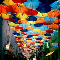 Floating Umbrella Installation in the Streets of Agueda, Portugal - Amazing Street Art Umbrella Street, Umbrella Art, Instalation Art, Colorful Umbrellas, Colourful Art, Colossal Art, Land Art, Art Festival, City Streets