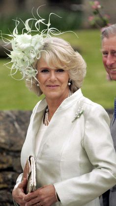 The Duchess of Cornwall looked beautifully elegant at the wedding of her daughter Laura Parker Bowles to Harry Lopes in 2006.