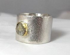 rough diamond silver and gold, contemporary wide band. $165.00, via Etsy.
