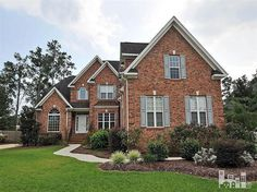 Great looking home! The color of brick and color of shutters go together well. Landscaping looks great too.