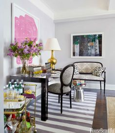 I like the modern desk with clean, metallic lines, gray striped rug, and open bar cart. From everything LEB: Lady Crush