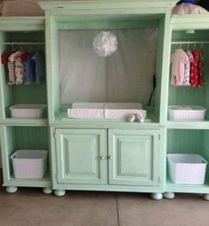 Entertainment center up cycled or redone into a baby changing station.