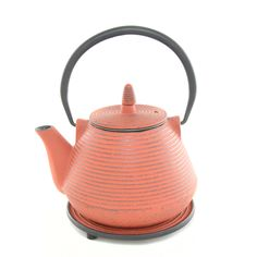 Ja Red Cast Iron Teapot: Red cast iron teapot, holds approximately 1.0l, and has a stainless steel removable leaf trap. It comes complete with a matching cast iron trivet.