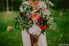 Channel a bohemian and hippy festival vibe with oversized exotic florals handtied with Indian silk scarfs. A different colour for each bridesmaid #weddingideas #boho #bouquetinspiration #festivalwedding #weddingbouquet Images by Lucabella. www.lucabella.co.uk