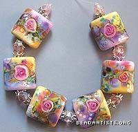 Floral lampwork (glass) beads.