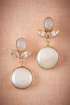 "BHLDN Eclipse Earrings in  New at BHLDN, $130 - Plated in 18k gold, a single freshwater pearl dangles from mesmerizing moonstone, and crystal.  By Atelier Mon 1.5""L, 0.5""W Nickel-free Brass, freshwater coin pearl, crystal"