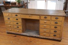 Hardware Store Counter with Drawers on Both Sides   From a unique collection of antique and modern apothecary cabinets at https://www.1stdibs.com/furniture/storage-case-pieces/apothecary-cabinets/