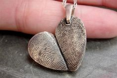 fingerprint heart necklace...I think this is so amazing and cool.  Gonna make D do this at some point.
