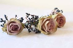 Buttonholes - Amnesia Roses with Berries - unusual but lovely