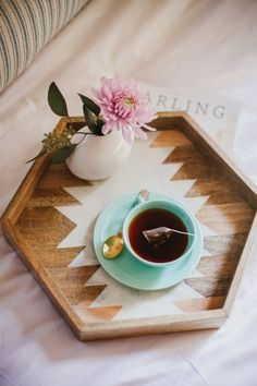 pretty tray -- from target (http://www.target.com/p/nate-berkus-wood-and-resin-hexagon-tray-16/-/A-14610722#prodSlot=medium_1_4&term=tray).  could be a good choice for our new coffee table. #TargetHomeDecor