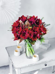 Simply stunning - velvety red amaryllis, with their signature large heads are hand-tied with berried ilex, magnolia leaves and hemlock for a magnificent arrangement which will really deliver the 'wow' factor this Christmas: http://www.waitrosedirect.com/product/luxury-red-amaryllis-ilex-bouquet/407457