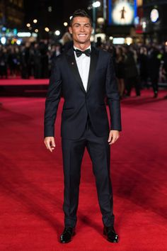 Wearing a SACOOR Brothers tuxedo, Cristiano Ronaldo is all smiles as he hits the red carpet for the world premiere of his documentary in London.