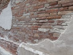 Venetian chipped plaster brick wall