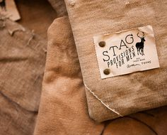Paper label on burlap with metal button pins