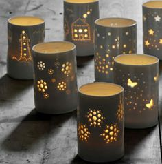 Luna Light: Ceramic Tea Light Holders do this with tin cans , punch hole pictures and create the ceramic look with one of the plast dip methods you can find on my art and craft tip boards, great light (Cool Crafts Candle Holders)
