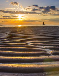 Rippled sandbars at low tide during sunset - Cape Henlopen State Park (the southern cape of the Delaware Bay) along the Atlantic coast of the United States  (Photo by Melissa Fague)