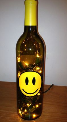 Smiley Face Wine Bottle Light by MamaJody54 on Etsy Love Smiley, Happy Smiley Face, Yellow Smiley Face, Smiley Faces, Lighted Wine Bottles, Bottle Lights, Smiley Emoji, Laugh A Lot, Get The Party Started