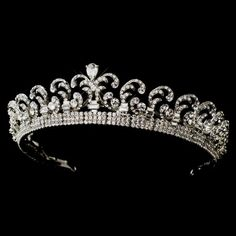 "howdivine.com.au  Royal Princess Kate Middleton Inspired Tiara Our Price:	$219.95 AUD  This royal inspired ""Kate Middleton"" tiara is as absolutely stunning. Intricately designed with a majestic scroll pattern and beautifully encrusted with sparkling rhinestones and featuring a stunning teardrop shaped Cubic Zirconia crystal in the centre  Size: 1.5"" tall with design extending 11"" on 14"" band with end loops."