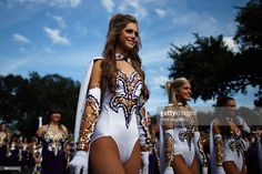 Members of the LSU Golden Girls march to the stadium before the LSU Tigers play…