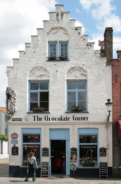 We at 'White Rooms in Bruges' love this one because of it's simplicity . Enjoy 'The Chocolate Corner' at Wijngaardstraat 17 - 8000 Brugge Belgium Oh The Places You'll Go, Places To Travel, Shop Fronts, Shop Around, Beautiful Places, Around The Worlds, Belgium Food, Travel Belgium, Stucco Exterior