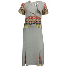 "Day Dress: ca. 1930's, rayon ""cellanes"" with neck tie and bold print insets at midriff, sleeves and godet pleats."