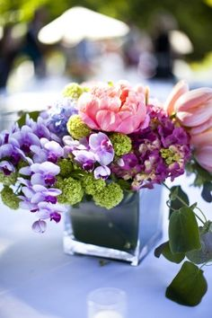 Pretty low-rise floral arrangement filled with colourful mini orchids, peonies, hydrangeas and tulips!