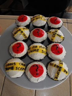 If I did not want to use a cake for the dessert because there is no room on the train for a dessert table, an alternative idea would having staff carry around these fun crime themed cupcakes.
