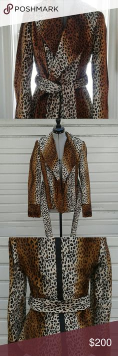 Handmade fuax fur leopard coat Faux fur leopard coat with black piping and lining. Handmade. Much care went into symmetry, and interest of design. Fits like a size 4. Like new condition. Jackets & Coats