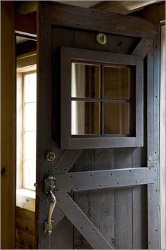 I LOVE Dutch Doors, but I also love this idea where they've used an old barn door on the house, too. ~Aileen