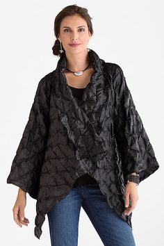 Geodesic Jacket by Mariam Heydari. The jacket for making an entrance this holiday. Bold, architectural shaping creates dramatic angles at the collar and hem, while puckered texture transforms the shimmery fabric into a landscape of shifting light.