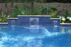 Swimming Pool with Water Features Located in Mt. Pleasant, SC Swimming Pool with Water Features Located in Mt. Backyard Pool Designs, Swimming Pool Designs, Pool Landscaping, Backyard Ideas, Backyard Patio, Garden Ideas, Pool Spa, Swimming Pool Fountains, Gunite Swimming Pool