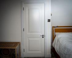 Bespoke white hardwood internal door.  Door details; Raised panels and polished chrome hardware
