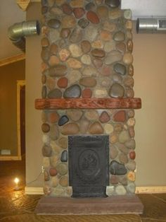 Cobblestone Fireplace tahoe cobblestone fireplace and kitchen. saw this at a recent