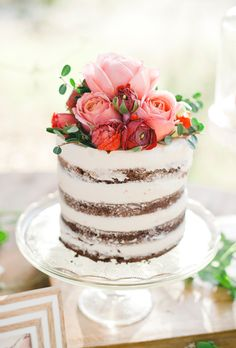 One-tier naked chocolate wedding cake with pink and red roses and peonies, by S'more Sweets.