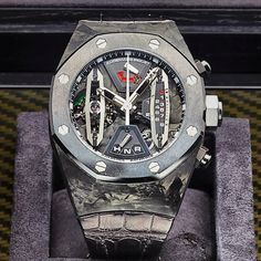 Audemars Piguet Prestige Sports Collection Royal Oak Carbon Concept Tourbillon Ref    26265FO.OO.D002CR.01  This amazing piece has Carbon case, skeleton dial, manual-winding Audemars Piguet Calibre 2895 movement with tourbillon, linear chronograph, power reserve, and selection indicator, many many hours of power reserved.  if you need info about this timepiece please contact us (800)635.3095 or info@thetimeshoppers.com   Our site will be fully working again soon! www.thetimeshoppers.com