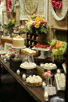 A buffet with food on different levels to add interest - boxes, cake stands, sometimes both.