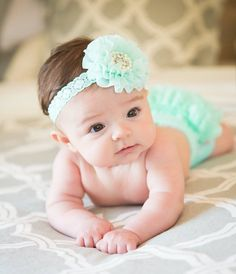 Mint chiffon flower headband features a soft mint chiffon flower which boasts sparkling rhinestones and pearls and is attached to a soft mint elastic.Perfect for Newborn photos, birthdays, weddings, an awesome baby shower gift or everyday dress up!